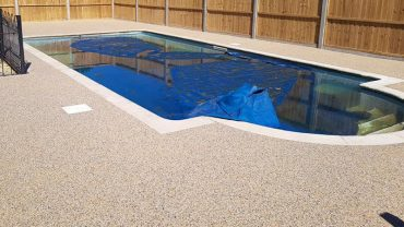 Swimming pool surrounding- resin bound stone surfacing