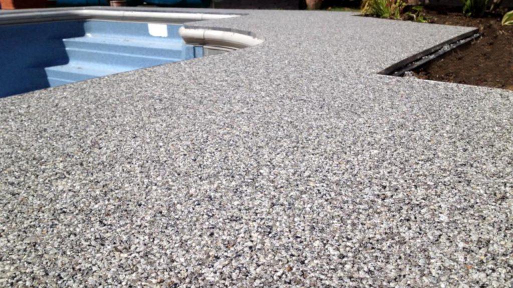 Resin Bound Stone swimming pool surround . Silver Quartz