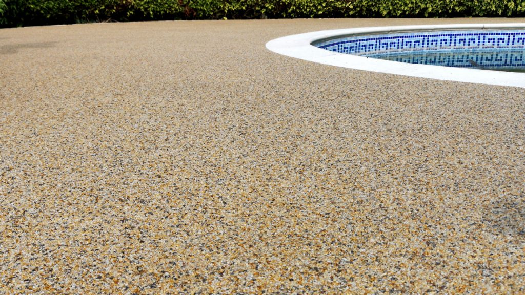 Resin Bound Stone Swimming Pool Surround in Guildford Sahara gravel