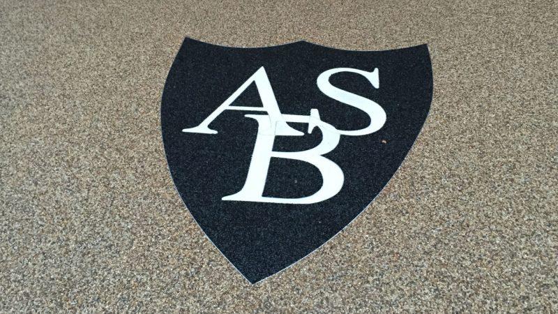 Logo - Resin bound stone and aluminium trim