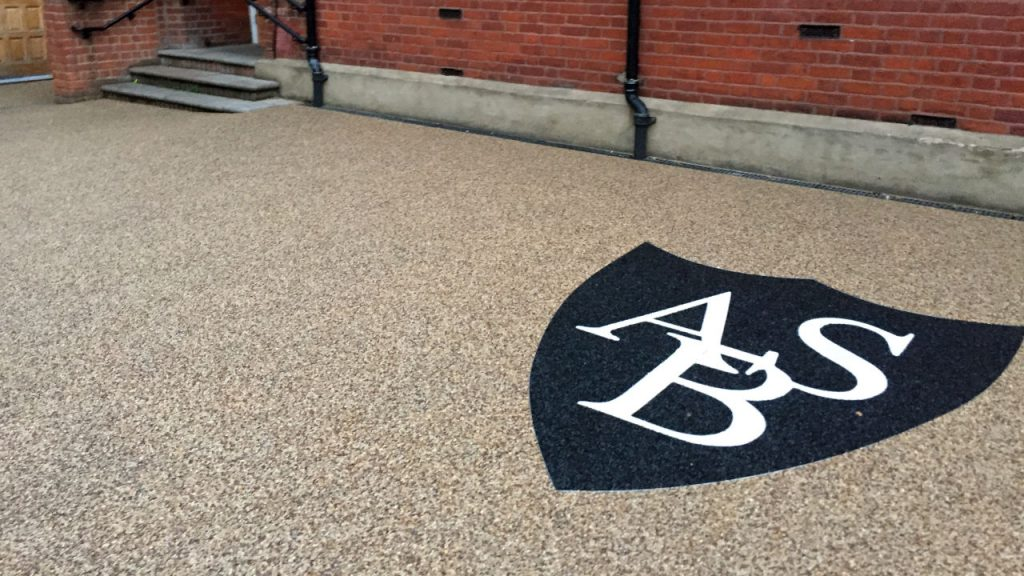 Logo - Resin bound stone and aluminium trim